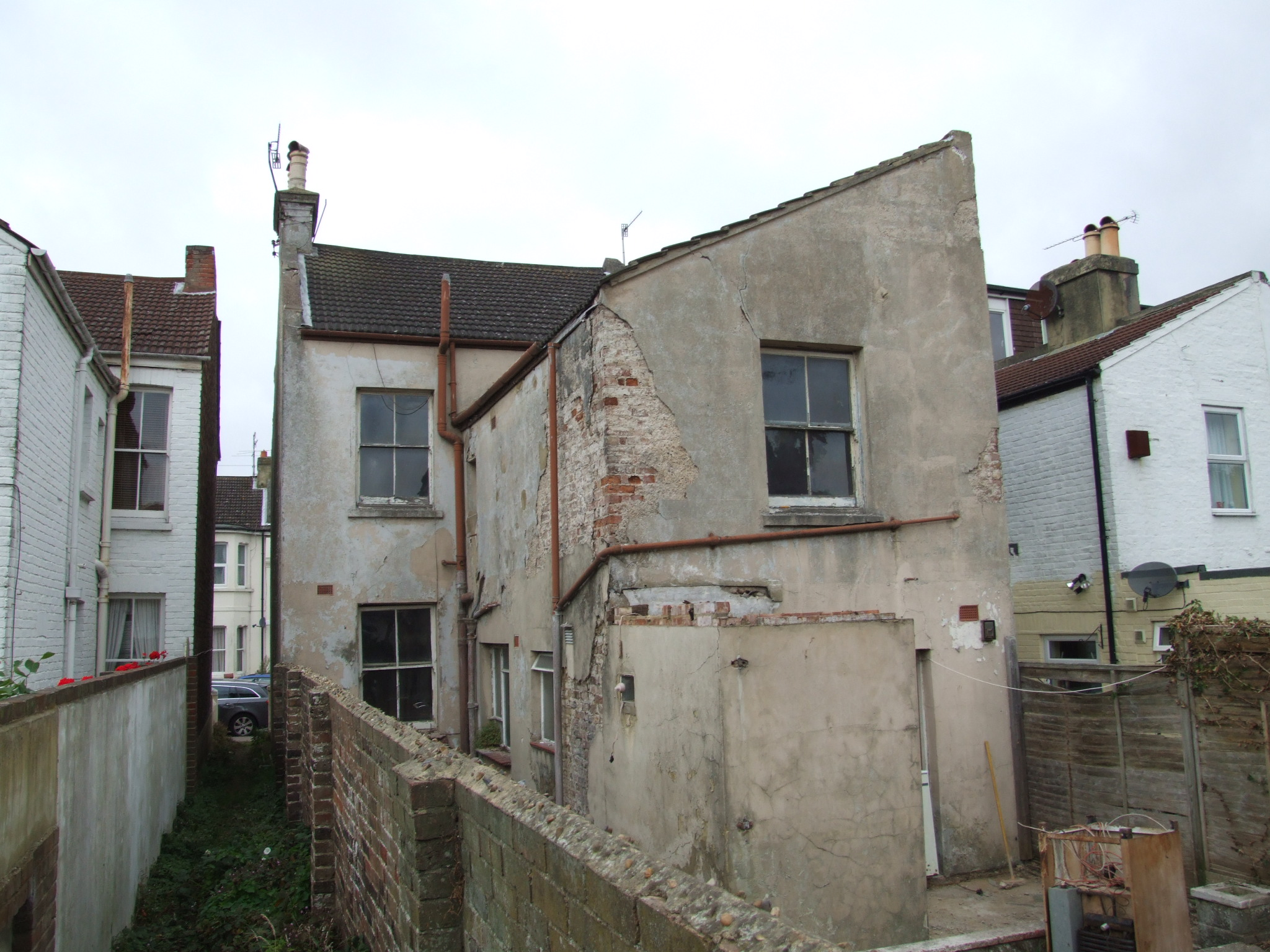 The rear of a completely renovated detached house before any work took place